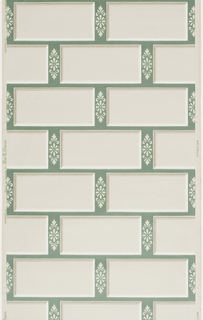 Alternating white bricks and white floral design on a green background printed on a white ground.