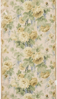 On background of vertical white lines large greenish yellow roses and blue wisteria among green stems and leaves. Straight repeat. Drop match.