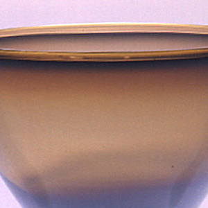 Wide bowl, slghtly flaring foot; opalescent glass.