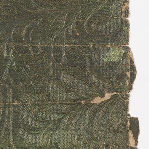 Dense pattern of foliage with scroll work or swagged lambrequin. Printed in all-over green color.