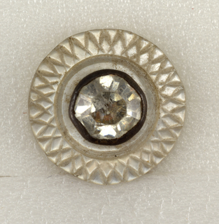 Button of pearl shell engraved in design of crossed lines; rhinestones in center.  Copper shanks.  On card 29