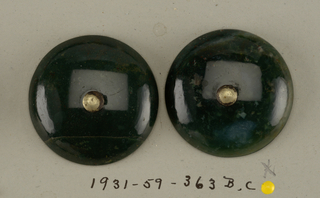 Components -b,-c,-e,-f are on card 18 -b,c: circular convex buttons of jade. Pierced in center by steel wire bent to form shank on underside. -d,e: slightly crescent-shaped pieces of jade pierced in venter by brass wire bent to form shank on underside.