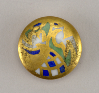 "Circular, molded porcelain blank. Obverse flat, decorated with abstract pattern in blue and green enamel, with gilding. Reverse with molded shank,gold bands surrounding ""1924/1934/SL"" in gold."