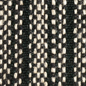 Irregular vertical tan stripe on a black ground. The warp is of thin black cotton and heavier undyed linen.  The black cotton wefts are used singly where interlacing with the black warp, and paired where interlacing with the natural warp, the effect being of a dense black band alternating with a speckled stripe.
