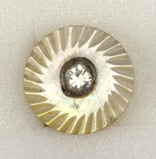 circular buttons showing imitation jewel [white glass] in steel setting on pearl disc with engraved radiating lines.  On card 29