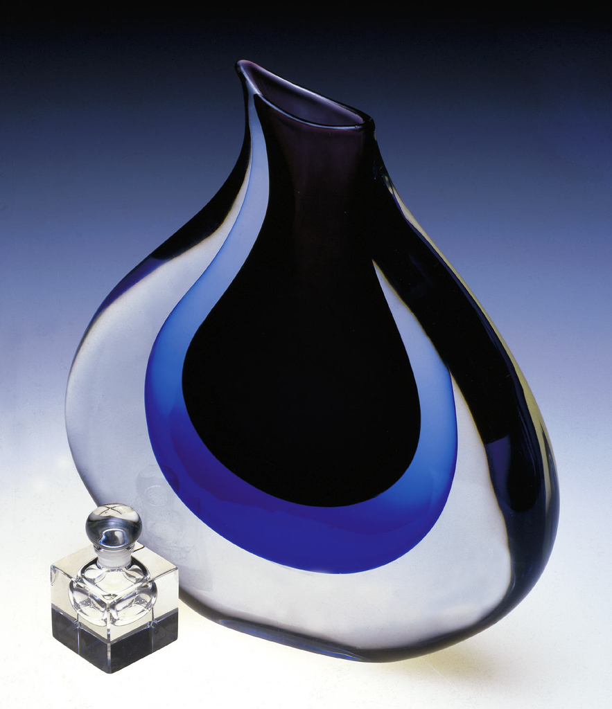 Flat, circular vase with short neck and slightly spouted lip; thick cased glass body, clear, over deep blue, over amethyst-colored glass.
