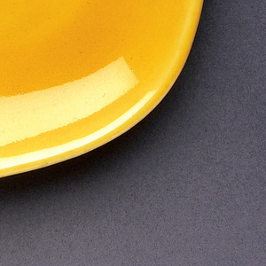 This is a square dinner plate with rounded corners in a bright yellow color.