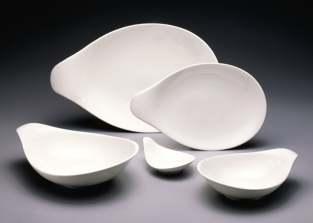 White teardrop form with raised everted handle, circular foot ring.