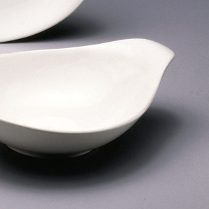 White teardrop dish with everted handle.