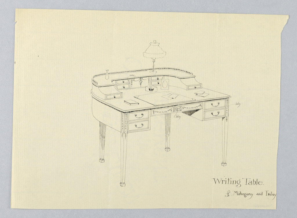 Semi-circular table top with inlaid central horizontal panel having 2 short drawers with single C-shaped pulls; raised on 4 straight, tapering legs terminating in molded square feet.  Rear of top has conforming section consisting of inlaid central panel flanked by 4 short drawers and small horizontal drawer on either end of section.  Low railing at back.  Vase, lamp, and inkwell on top.
