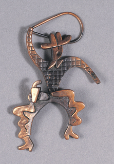 Brooch in form of cowboy with lasso.