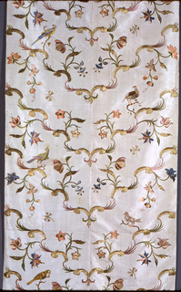 Bed hangings of heavy white silk, embroidered in gold thread, gold foil strips, and colored silks. Each panel is made up of two breadths of fabric seamed down the center and is lined in white silk plain weave. The design is arranged so that golden rococo curves meet at the center seam to form a symmetrical v-shaped pattern, with flowering branches and birds, worked in satin stitch in colored silks. While the flowers are symmetrical, the birds are vertically off-set; each panel shows eleven birds, all different, which appear to be taken from a set of ornithological prints by Xaviero Manetti. Metallic effects in several textures are created with couched crimped gold lamella and couched foil-wrapped silk-core threads.