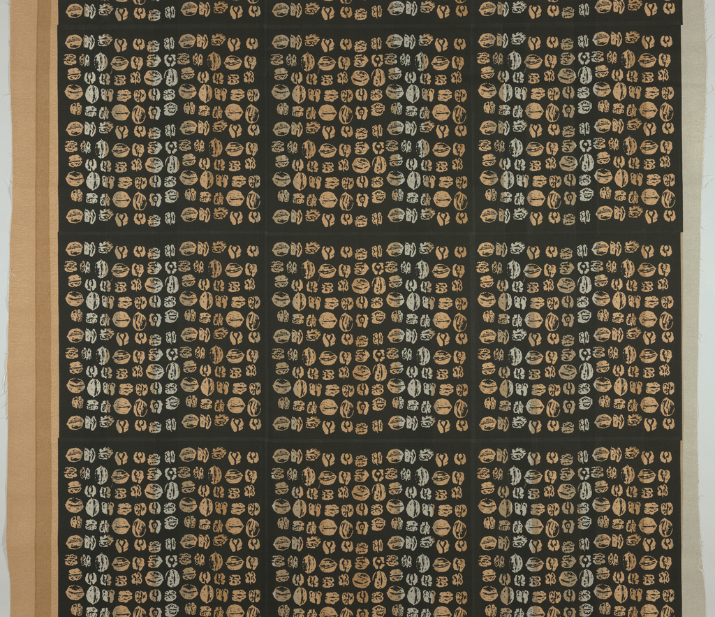 Length of heavy cotton with rows of walnuts arranged in a grid. Hand-pulled stripe of grays and browns, overprinted with a black background screen which leaves the walnuts in irregular multitones.