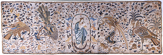 Altar frontal composed of five panels of embroidered silk. The center panel shows the Madonna and Child, surrounded by stars, in an oval made from pearls and rosettes, and supported by angels on all sides. The remaining panels each feature a large bird, surrounded by flowering branches filled with smaller birds. Metallic fringe all the way around.