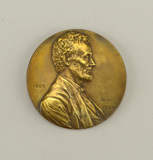 """Circular form; obverse: bust of Abraham Lincoln facing right flanked by engraved dates, 1809 / 1909; reverse: eagle on rock over sea; in field: """"PRESERVE PROTECT / DEFEND""""."""