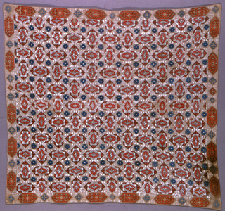 Allover repeating design of a lozenge placed horizontally and vertically in ivory, red, blue and black. Border of lozenges in salmon and blue. Cover resembles tile work.