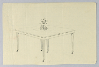 Rectangular molded top with dividing stretcher at center, raised on 6 tapering plain legs on casters - one pair on either side and one pair at center; at center of table top, flower vase on doiley.