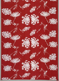 Length of cotton with a design of scattered Queen Anne's Lace. Hand-pulled red strié ground. Stems and leaves are screen printed in red to give shadow effect, and flowers and screen printed in white.