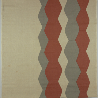 Heavy and tightly woven natural linen showing an off-center pattern of two sets of columns in gray and rust zigzags, or alternately wide and narrow shape.