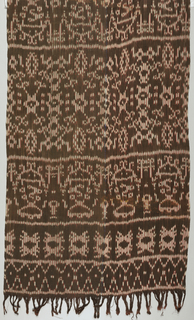 Warp ikat in dark brown and red with geometric floral band across the middle. Narrow geometric bands at ends.