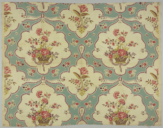 Polychrome block print on white linen. Alternating rows of many -lobed medallions with purple outline, contain flowers, set on an aqua ground patterned by small sprigs of red flowers. One row of large medallion with basket of red and pink flowers with purple and green leaves. This row connected to row of smaller medallions containing a red and pink flower with green and purple leaves, growing from a mound.