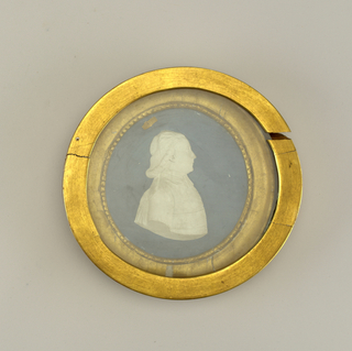 Presumably of Texier, Canon of Chartres. Jean-Charles-Nicolas Brachard (1766–1830) after a drawing by Perrin. -a: Circular medallion with young clergyman's relief portrait bust in right profile; background painted blue. Incised on arm: Brachard fecit 1790; -b: almost round oval frame, gilded, with pearl molding; -c: gilded, glazed cover frame.