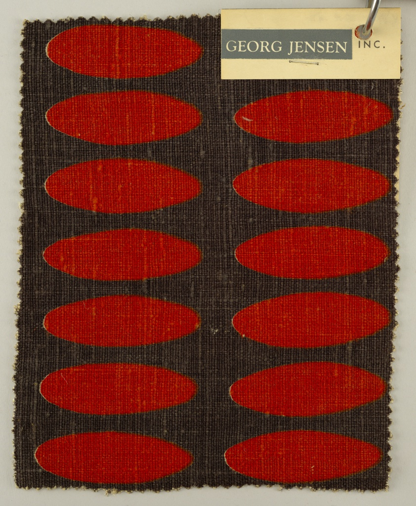 Sample with two columns of red elongated ovals on a black ground.