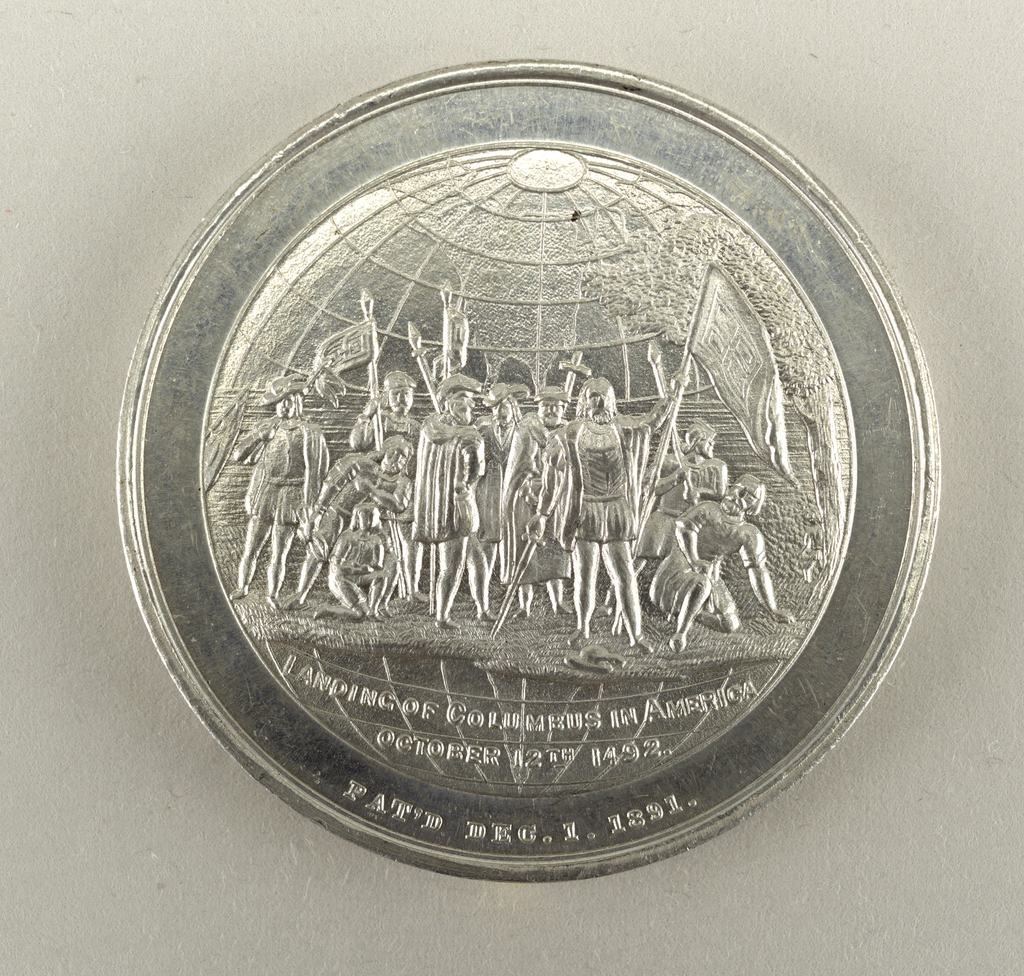 Medal commemorating the World Columbian Exposition at Chicago. Obverse: City view on globe; above: WORLD'S FAIR; below: SOUVENIR Reverse: Landing of Columbus