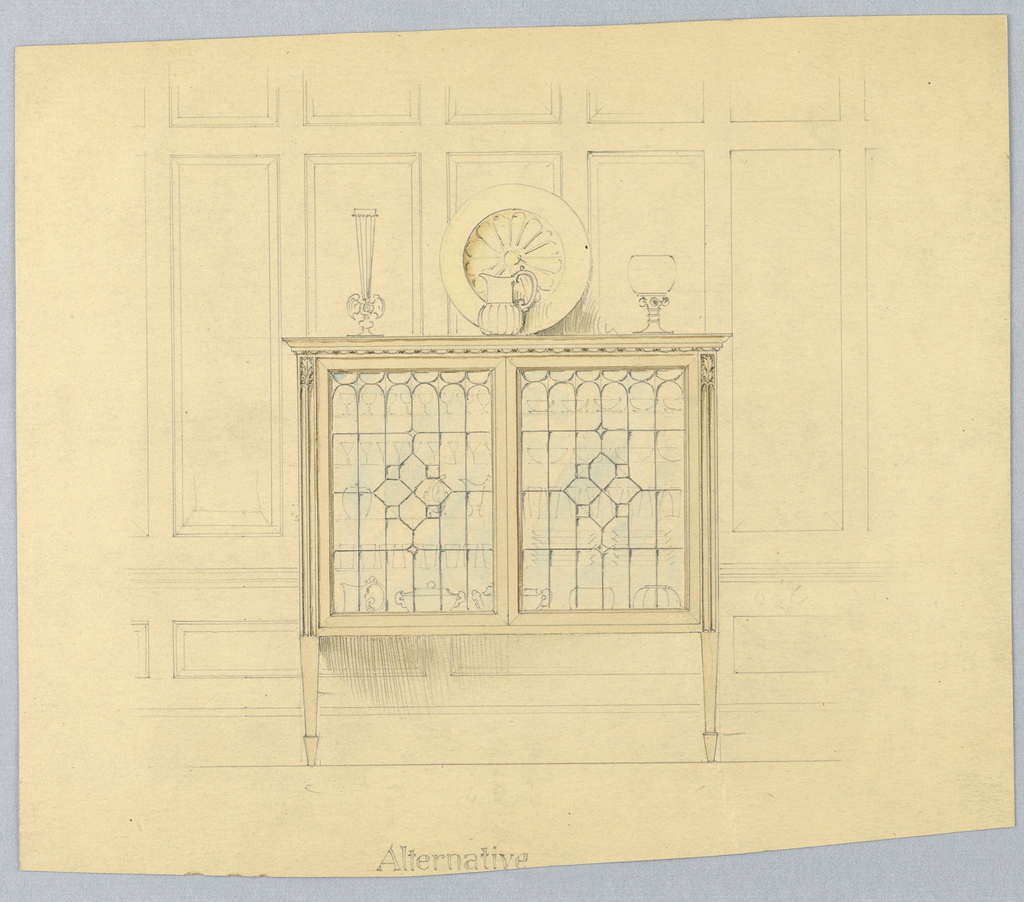 Against background of suggested wood paneling, a rectangular cabinet with 2 glass doors; molded frieze-like top surmounted by brass platter suggested in yellow watercolor plus pitcher and 2 vases; 2 front tapering legs extend into reeded pilaster-like elements on either side of glass doors and terminate in carved acanthus leaves; wooden parts of cabinet suggested in light brown watercolor and glass doors in blue watercolor.