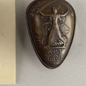 """One patinated bronze triangular mounted plaque (-1a) in original case; three small triangular bronze pins (-1b/d). Each showing classical female figure in phrygian cap, holding sword above her head and striding before rising(?) sun and eagle in flight; inscribed """"Victory (in banner above figure), Art, War, Relief"""""""