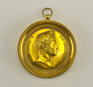 Medal commemorating Tsar Alexander I of Russia. Obverse shows laureate head of the Emperor, and the inscription: ALEXANDER I. IMP. RUSSORUM. Uniface, in contemporary ornate frame with suspension ring.