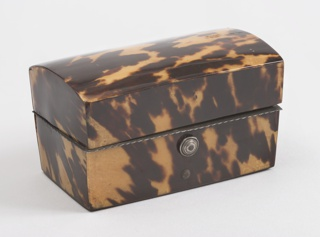 Rectangular tortoiseshell box with arched lid (a), containing ink well (b), bottle for sand (c), pen (d), pen nibs (e/f).