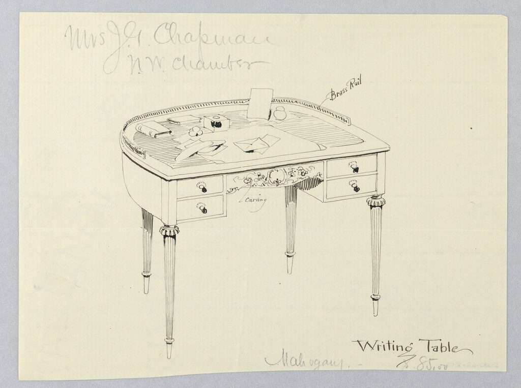 Semi-circular table top with brass railing at back; raised on 4 fluted columnar legs terminating in slim tapering feet with flute stops; center drawer carved in floral motifs and flanked by 4 shallow drawers with round knob pulls; atop table: ink well, sand container, envelopes, etc.