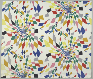 Length of printed cotton with pinwheels of diamonds in bright colors on a white ground.