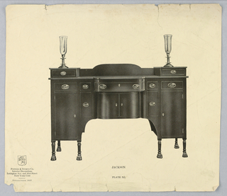 Oblong sideboard with convex center front drawer, 2 doors underneath; above top of sideboard, on either side, a cabinet raised on 3 turned and fluted animal paw feet and topped by drawer and a vase; molded backsplash.