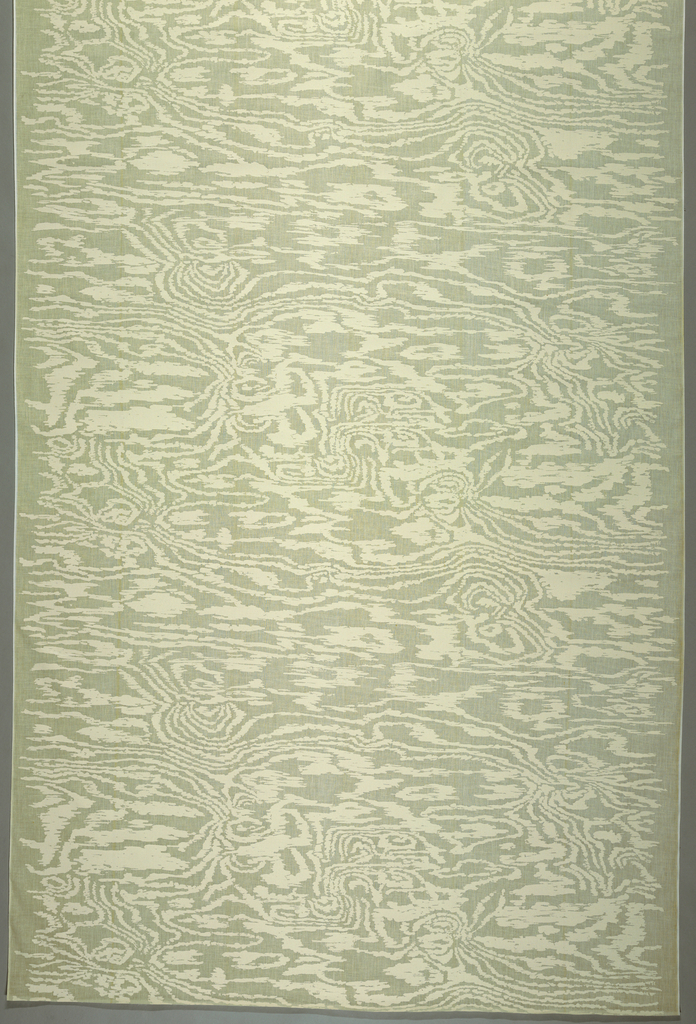 Length of sheer off-white cotton muslin, screen printed with a woodgrain pattern in off-white.