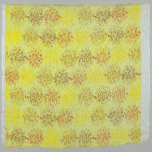 Shell-like motifs in horizontal groupings in opaque oranges and browns on a white ground printed with the same motif in yellow, with tiny scattered red dots.
