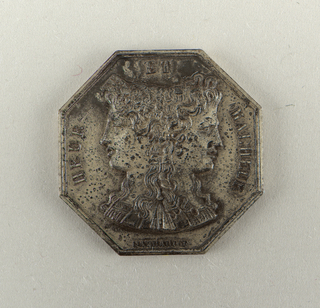 Octagonal gambling token. Obverse shows the double bust of young Janus. Inscription: HEUR ET MALHEUR (happiness and woe) / GAYRARD-F. Reverse shows Aurora.