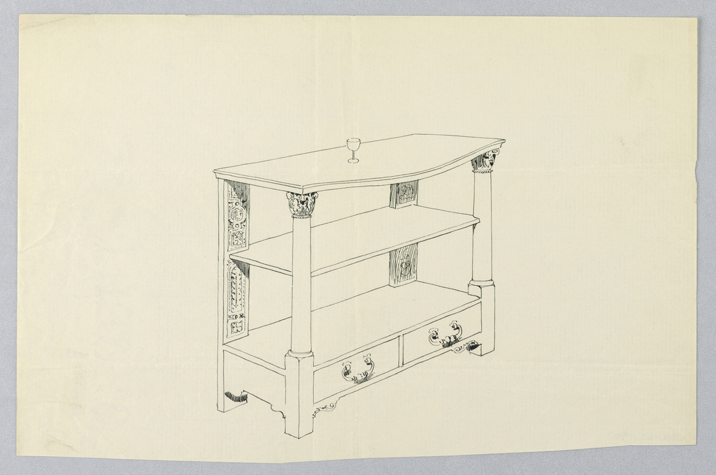 Table with oblong top (convex front) resting on two Corinthian column front supports and two flat, ornately-carved back supports.  Shelf unit in middle. Base is made up of two drawers (a unit on short legs so it is raised off the floor).  A wine glass stands atop the table.