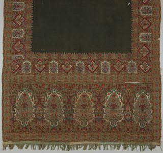 Rectangular shawl with wide borders at each end and narrow borders on each side; made up of woven and cut pieces of fabric with a set-in black center or field.  The primary border at each end contains five elaborately foliated cones.  The ivory is silk throughout.