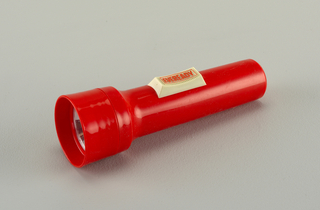 "Red plastic cylindrical body and circular lamp housing; large gray rectangular on/off button with the word ""EVEREADY"" within rectangle, in red."