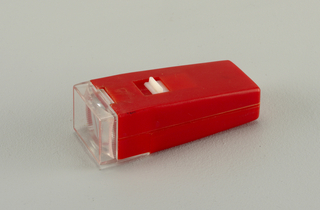 Red body of tapering rectangular form; clear rectangular lens.