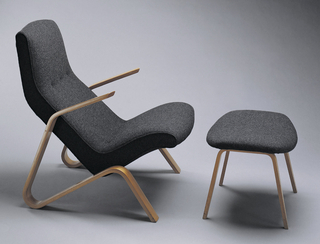 High-backed lounge chair with bentwood elements forming continuous arms/legs; upholstered in grey wool.