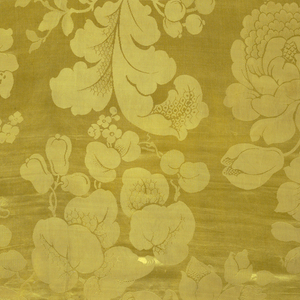 Yellow, large scale pattern with large flowers including daffodils.
