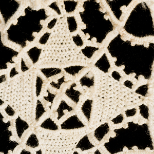 Small fragment, probably student work in a small-scale geometric pattern connected by brides.
