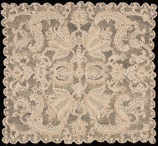 Large square of Burano lace with a scalloped outline showing symmetrically placed tulip pattern. Outlined by cordonnet and interspersed by portes.