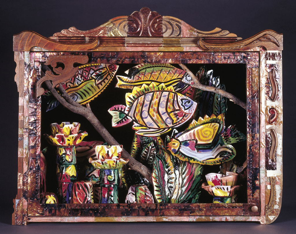 Wooden cabinet (1992-39-1) of rectangular form with large hinged plexiglass door, small circular knob at bottom right corner; front of cabinet decorated with applied pieces of found wood in various shapes and lengths forming decorative pediment and scrolls at top and sides; exterior surface decorated with applied small metal sheets, some embossed and patinated.  Cabinet holds 27-piece ceramic dinner service (1992-39-2/28) in forms of fish and water plants, glazed in various colors, arranged to depict aquarium scene, some fish 'swimming' amongst  two wooden branches.
