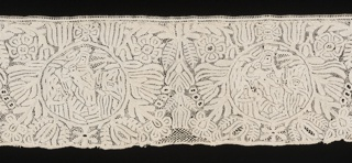 Design showing medallions of Modonna and Child set into floral pattern.  The upper edge originally scalloped has been filled in to form a straight edge.