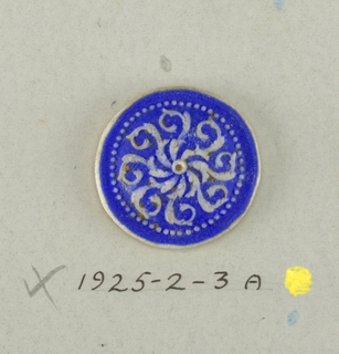 Medallions in the style of Wedgwood Jasperware - flowers with eight curled petals and ring of small dots in white on blue ground.  On card 4