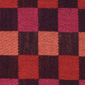 Black warp with pink, orange and light orange wefts, alternating color every inch to form a checked pattern. Selvedge on one side and cut on other three sides.